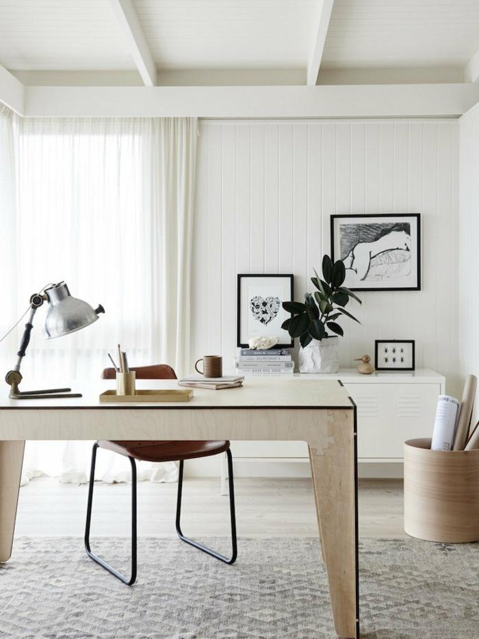 ideas para decorar la oficina en casa, mesa escritorio ikea, paredes blancas y alfombra moderna en color beige, cuadros decorativos en la pared