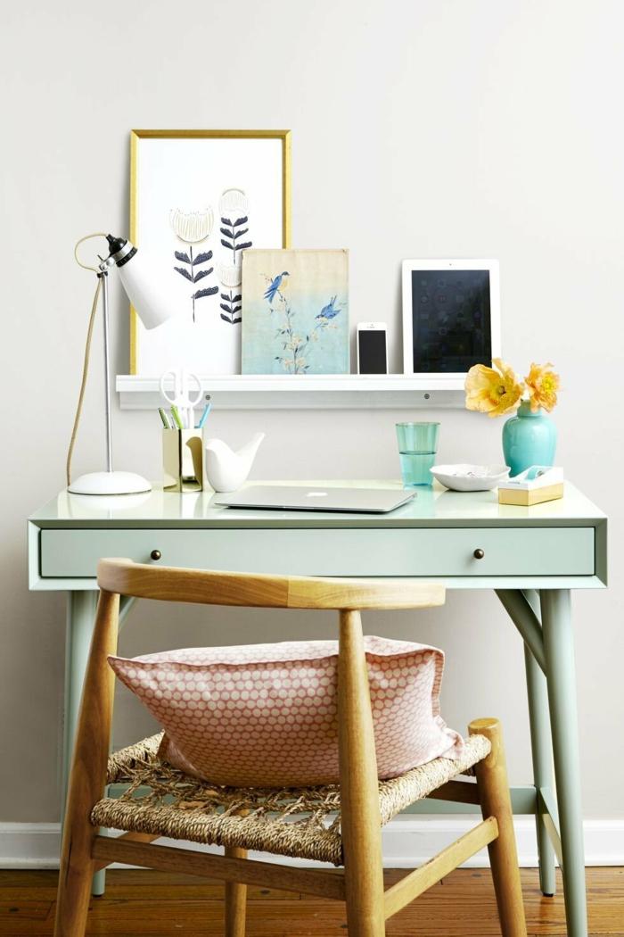 ideas para decorar tu espacio de trabajo en casa, escritorio moderno pintado en color verde claro y cuadros decorativos
