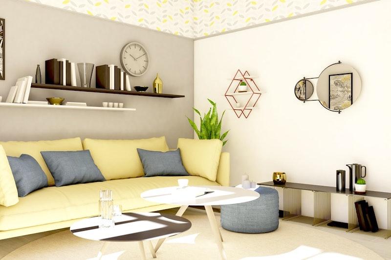 salón en colores pastel amarillo y sofá beige pálido en amarillo